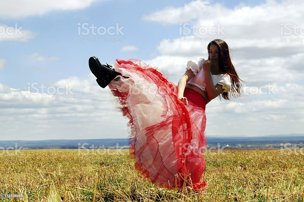 Country girl kicking stock photo