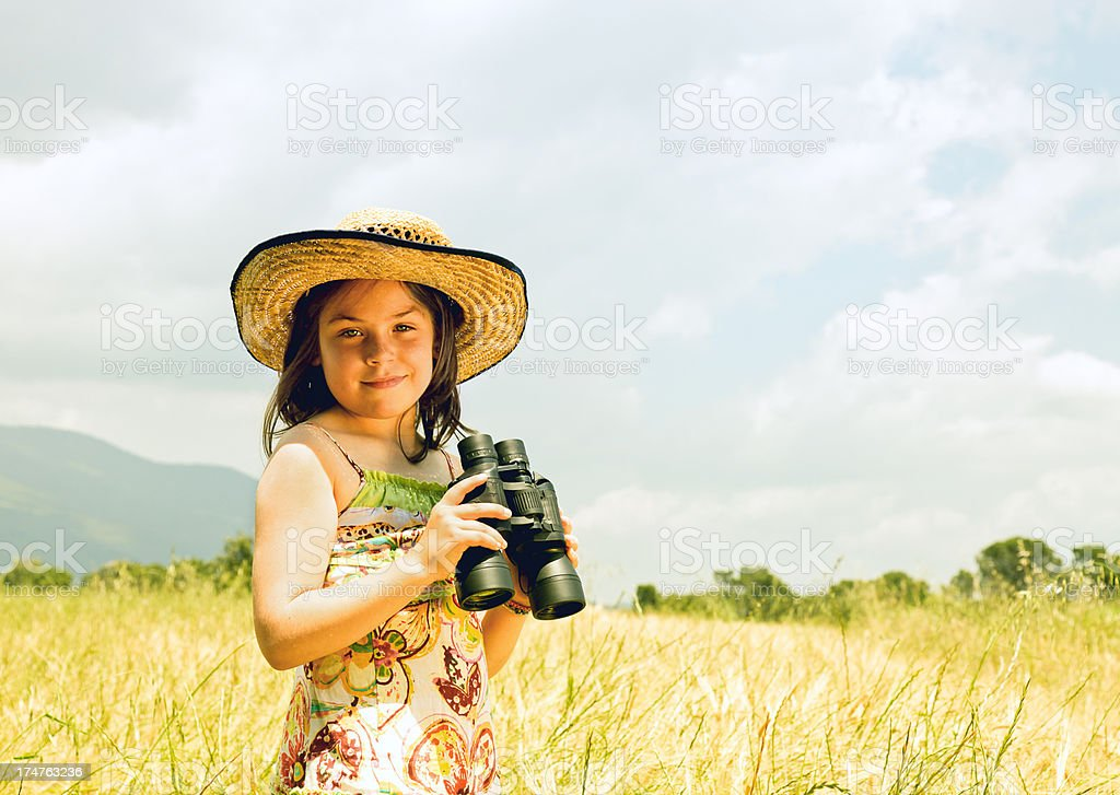Country girl with binoculars stock photo