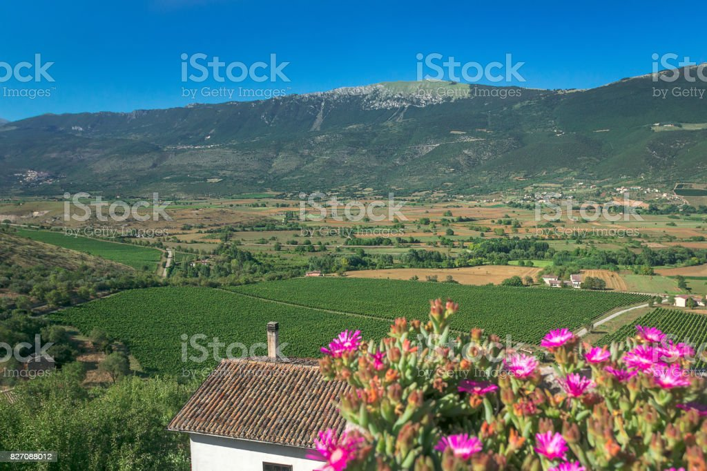 Country green valley landscape with mountains in Italian Abruzzo stock photo