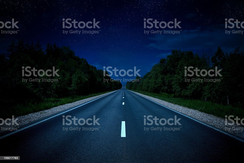 Country highway in the night stock photo