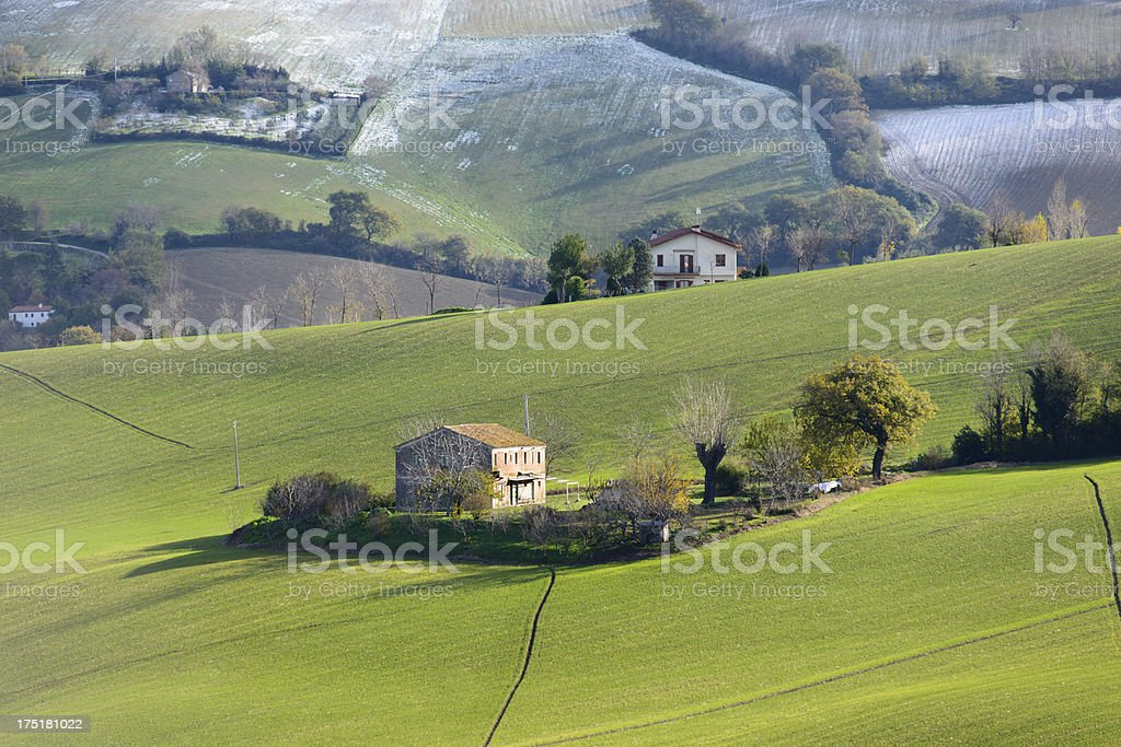 Country house among green fields royalty-free stock photo