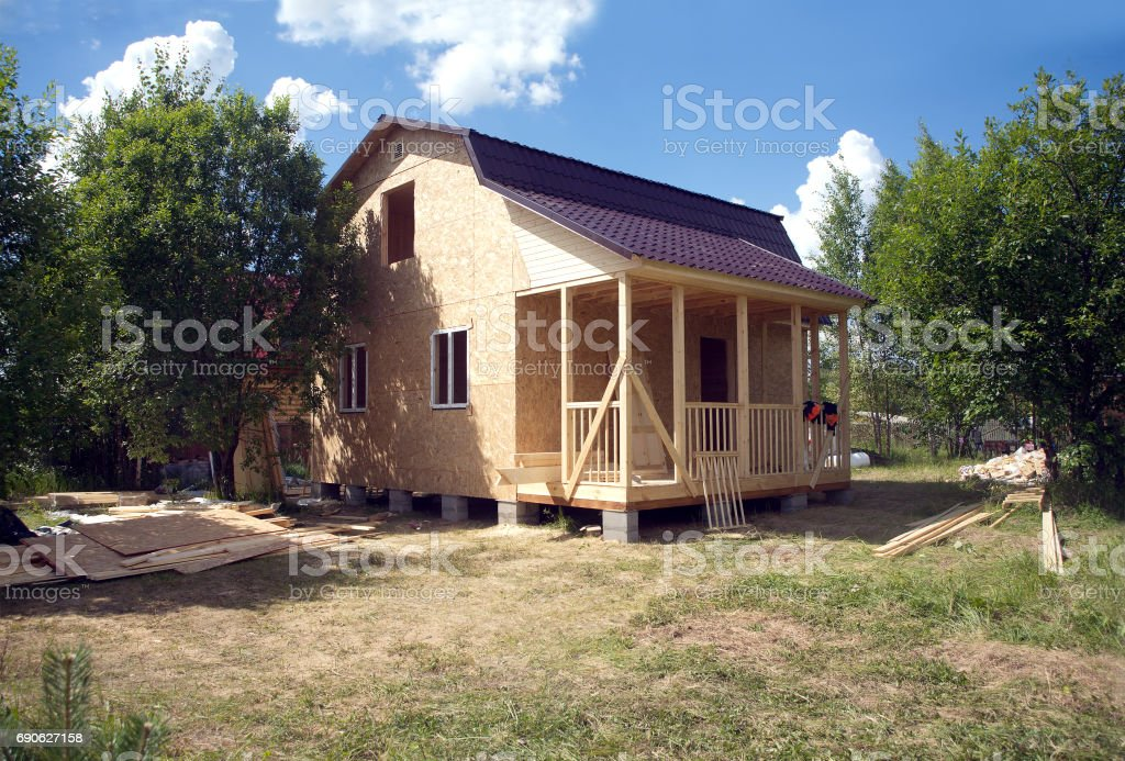 Country house construction on sunny summer day stock photo