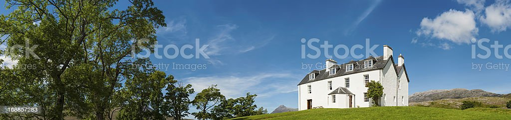 Country house in picturesque summer landscape panorama stock photo