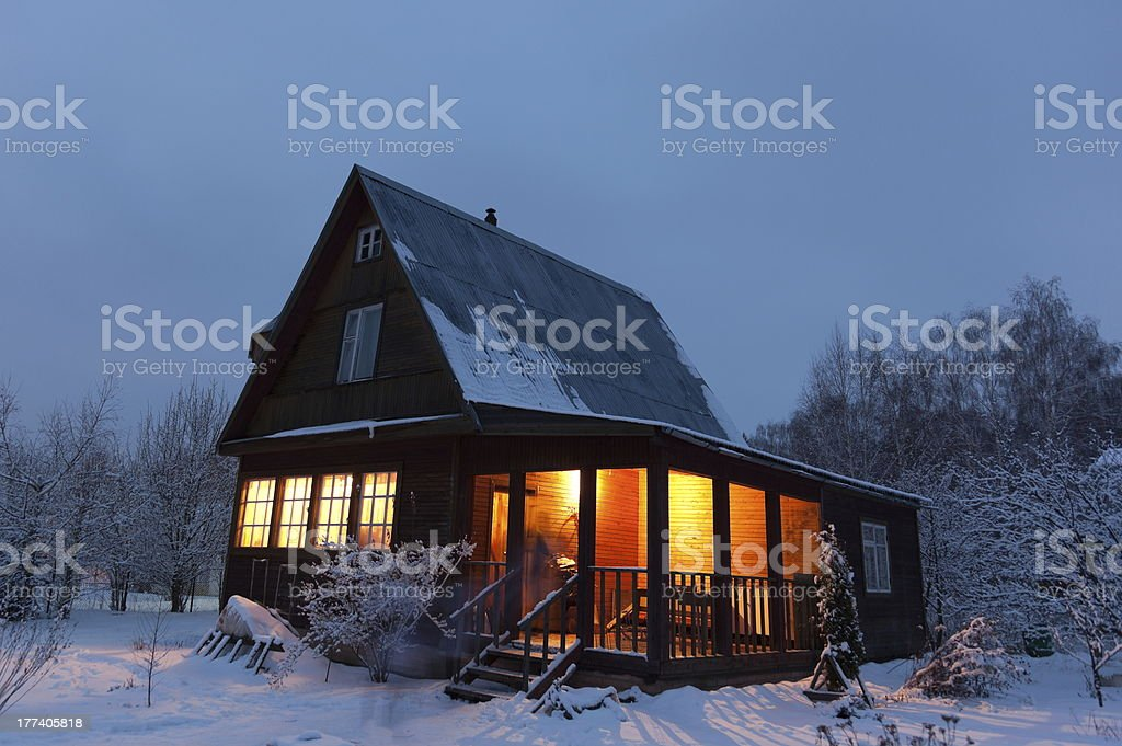 Country house (dacha) in winter dawn. Moscow region. Russia. stock photo