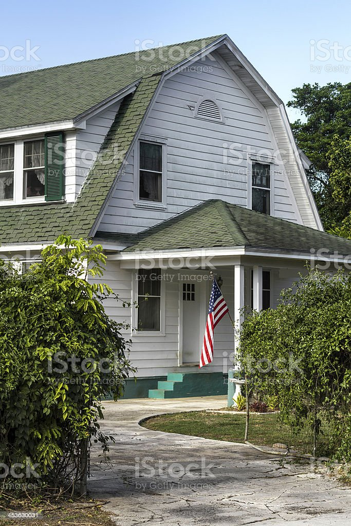 Country house with American flag on porch royalty-free stock photo