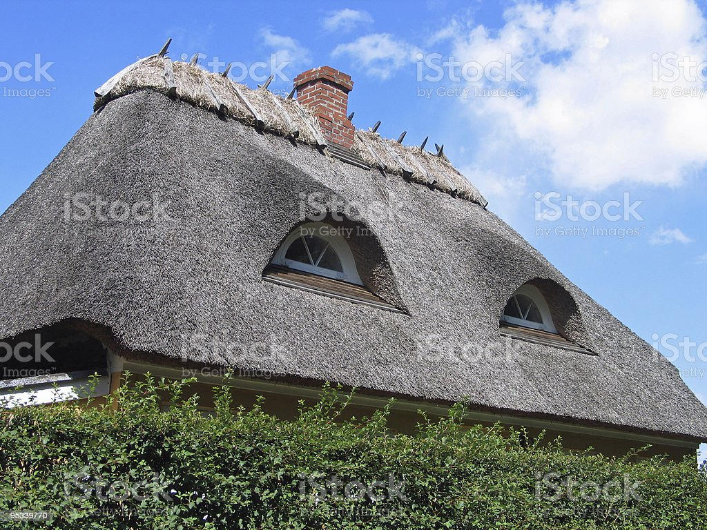 Country house with  thatched straw roof royalty-free stock photo