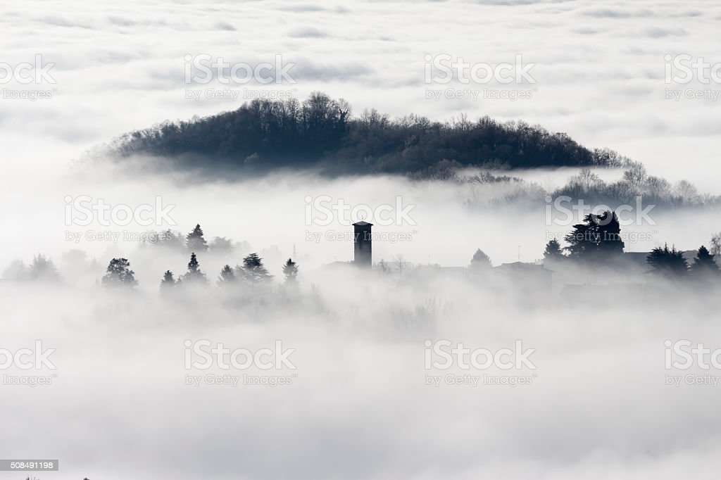 country in the Po Valley immersed in the fog stock photo