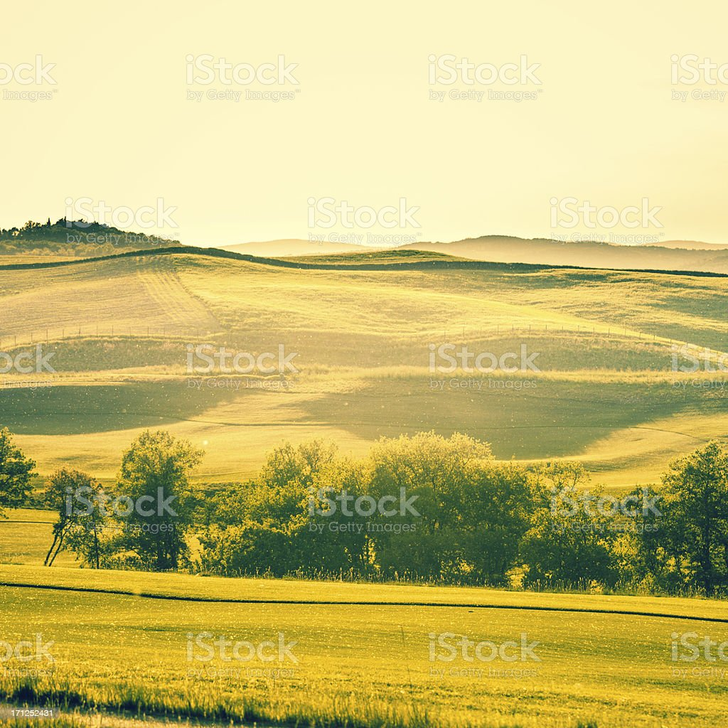 Country Landscape at Sunset in Tuscany royalty-free stock photo
