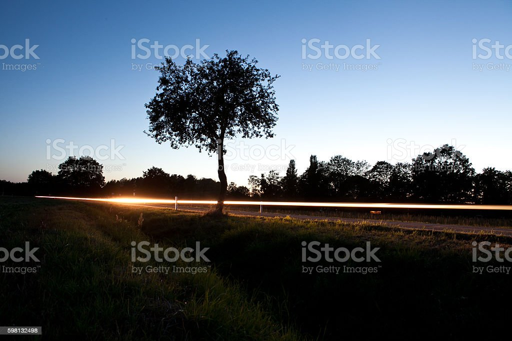 country lane at night time exposure stock photo