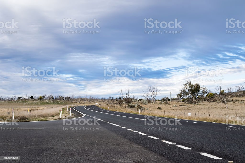 Country main road at intersection fading into the distance stock photo