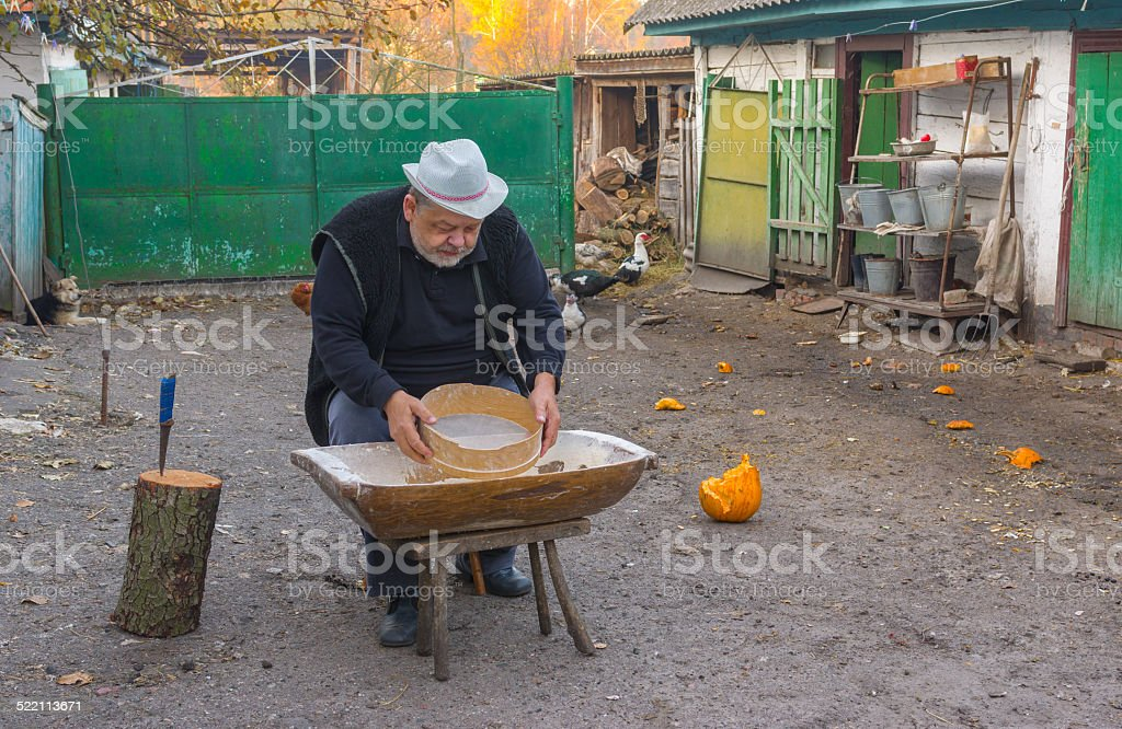 Country man doing daily work at the homestead stock photo
