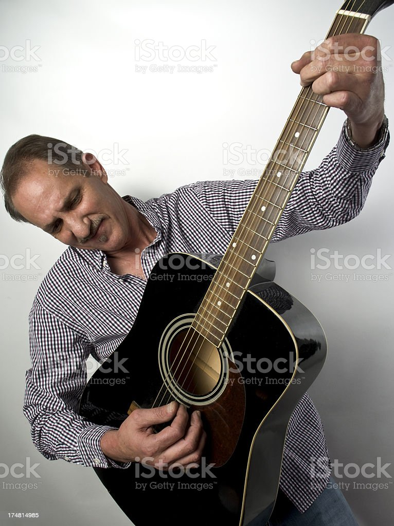 Country Music Acoustic Guitarist Performing Strumming And Picking royalty-free stock photo