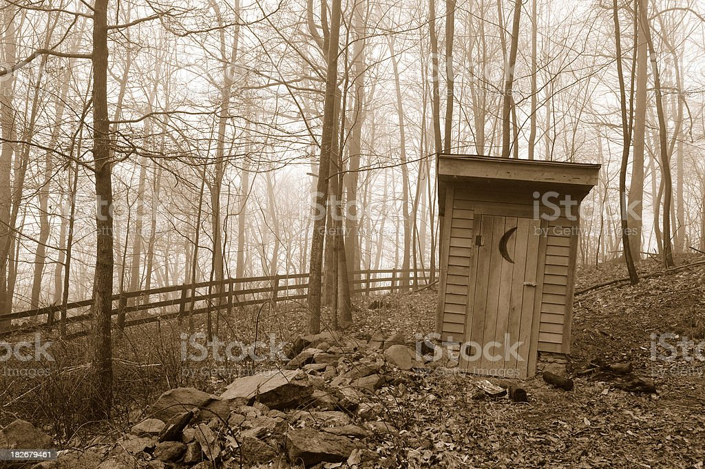 Country Outhouse in Fog and Mist stock photo