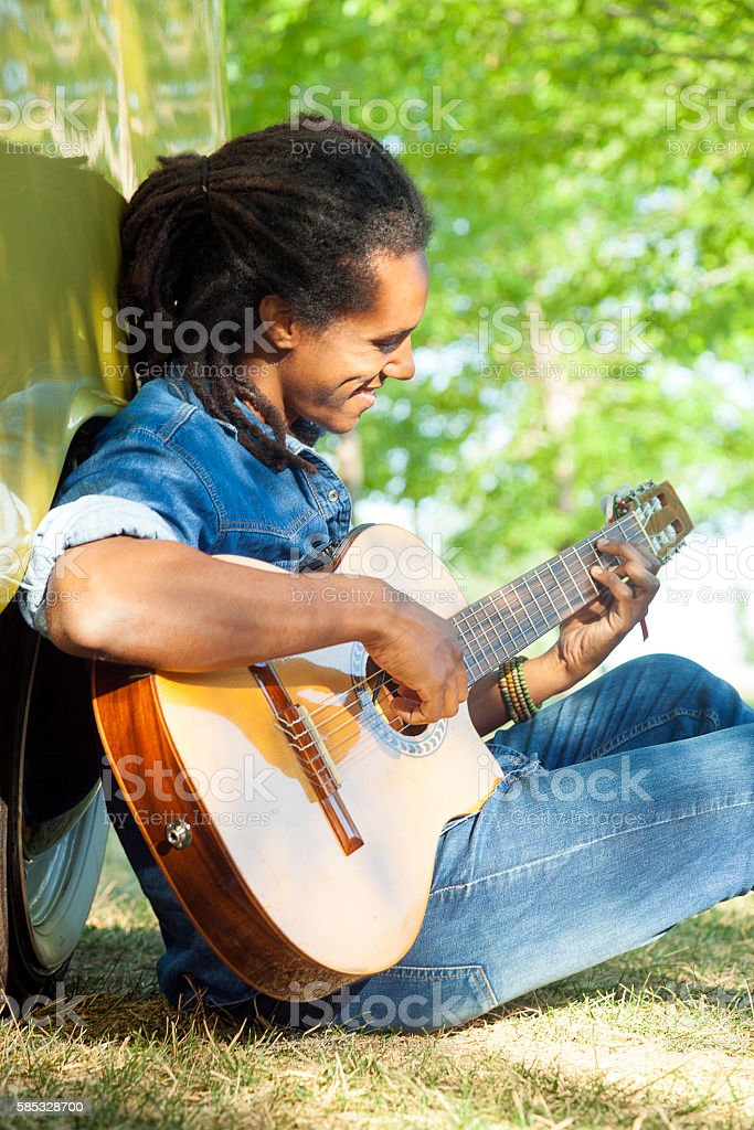 Country relaxed guitarist stock photo