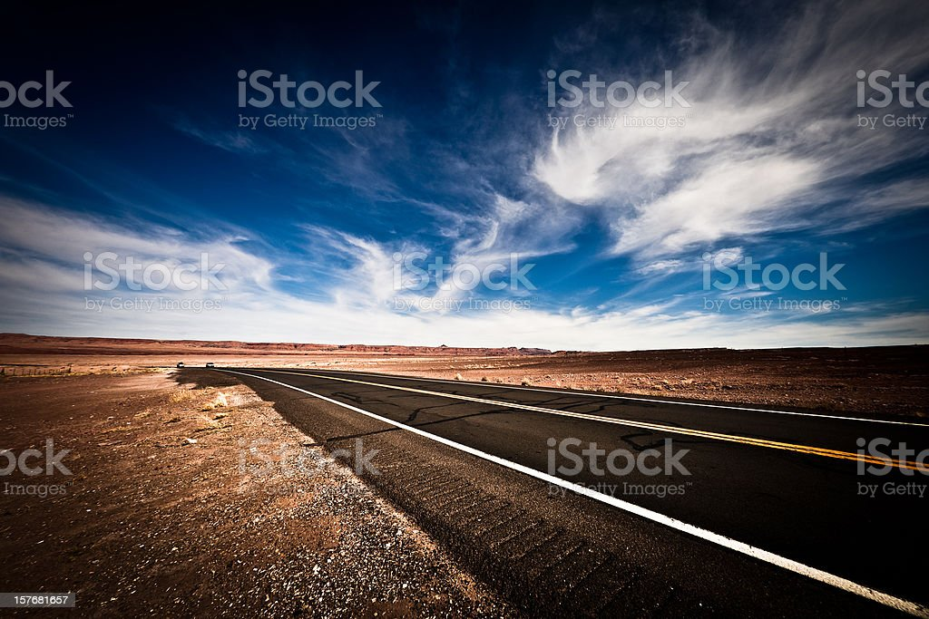 Country Road Against Vivid Blue Sky Nobody royalty-free stock photo