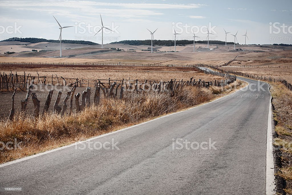 Country Road and Eolic Power Generators stock photo