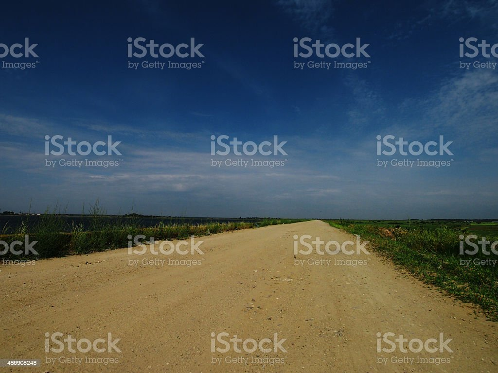 Country road & blue sky stock photo