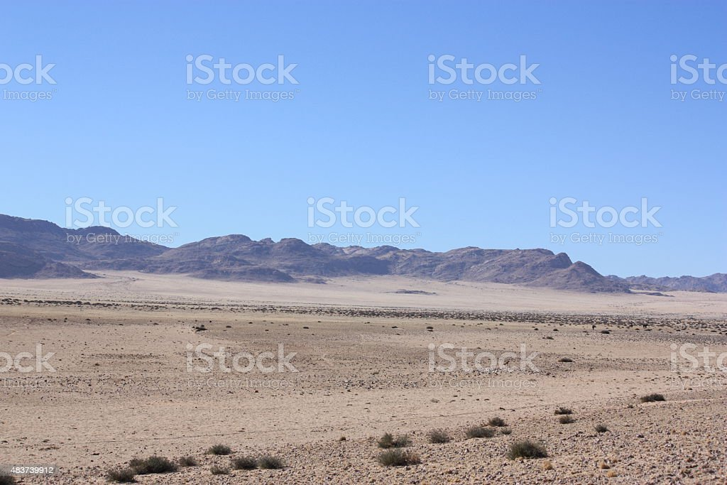 Country Road in Namibia under a blue sky stock photo