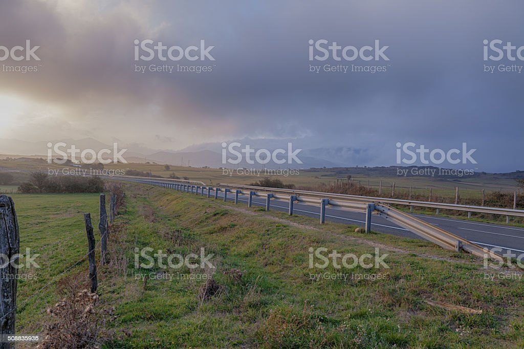 Country road in the fog. Spain, Cantabria. stock photo