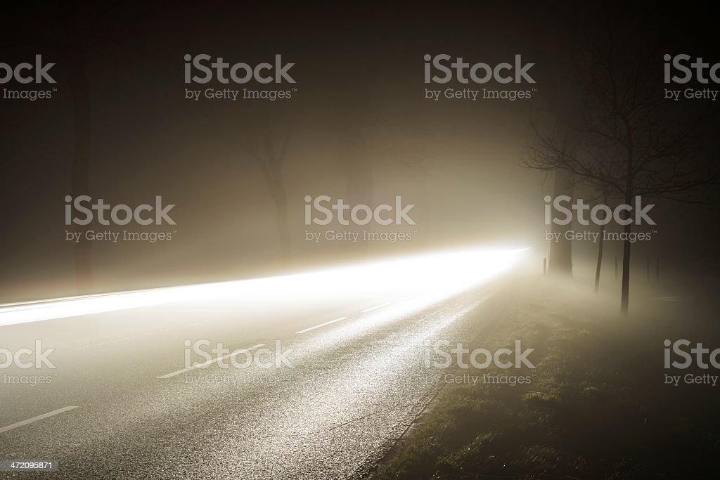 Country road in thick fog stock photo