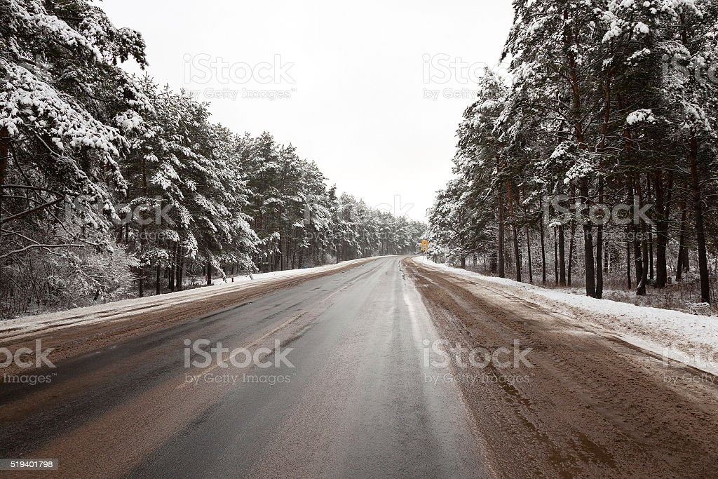country road in winter stock photo