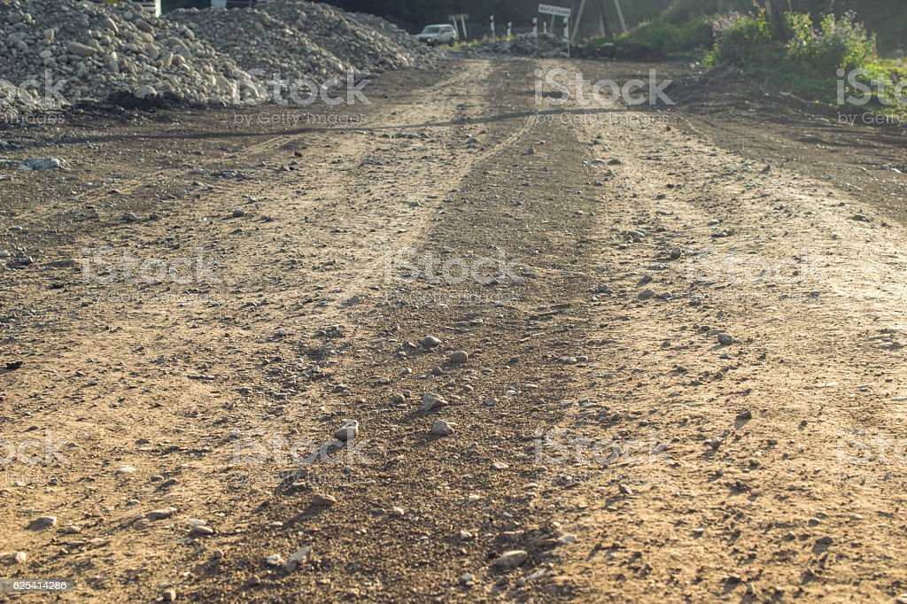 Country road near building site, Altai mountains, Russia stock photo