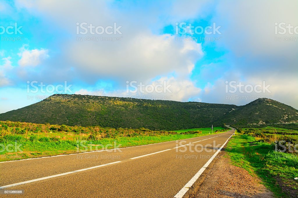 country road on a cloudy day stock photo