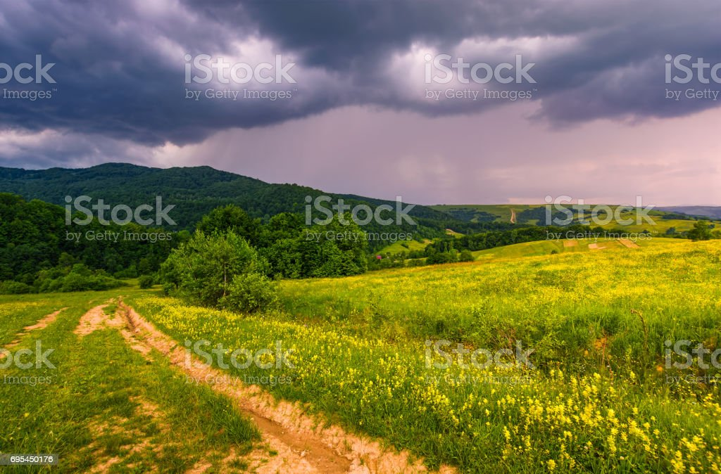 countryside summer landscape in mountains before the storm. country...