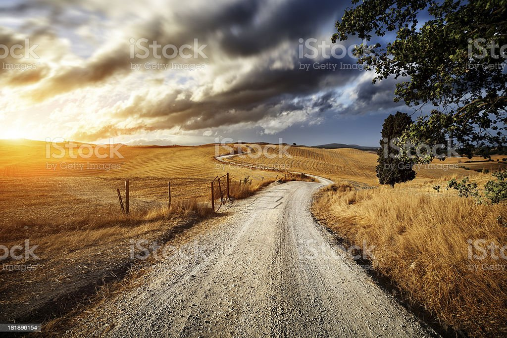 Country road through the fields of Tuscany stock photo