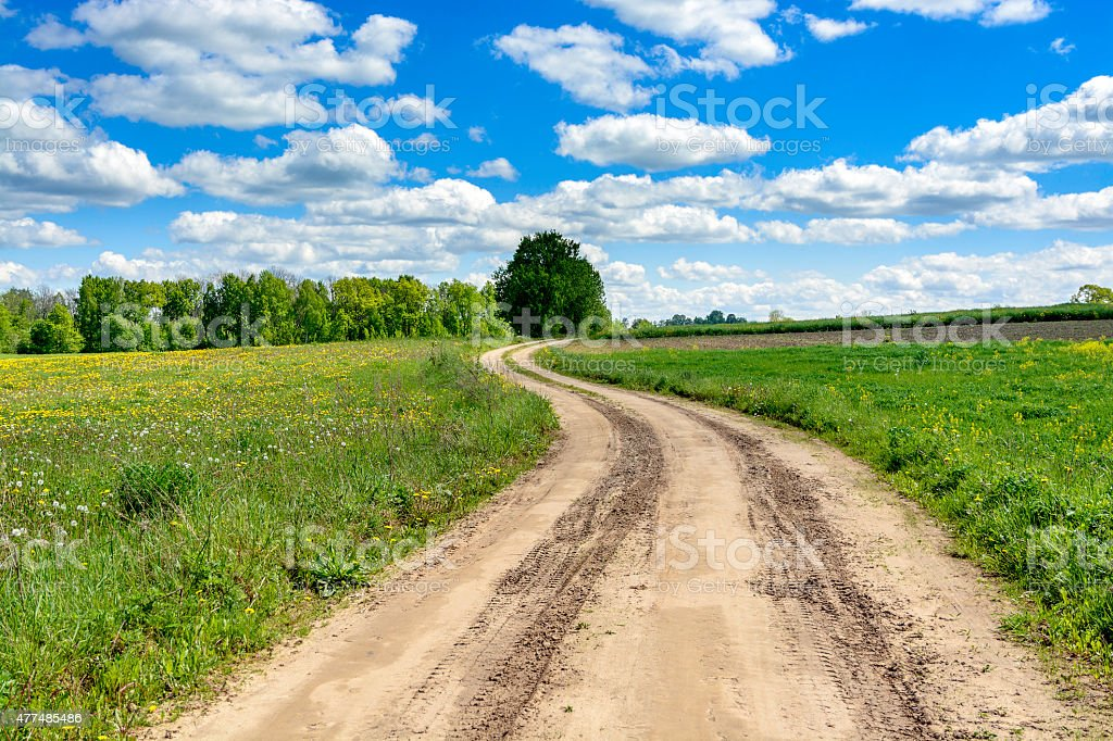 Country road with cloudy sky stock photo