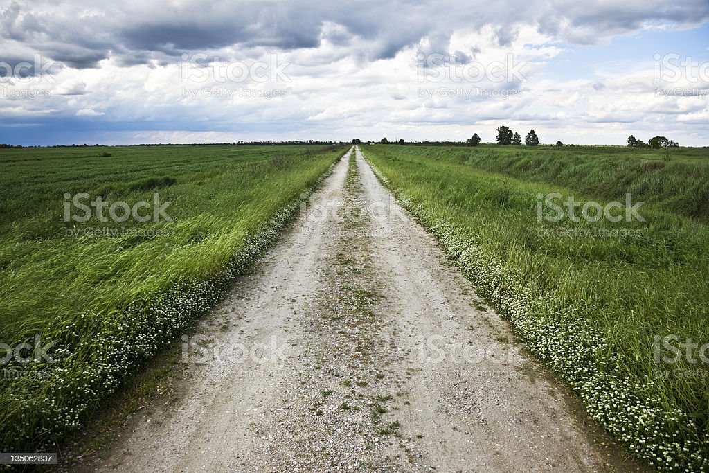 Country road with dramatic sky, Italy royalty-free stock photo