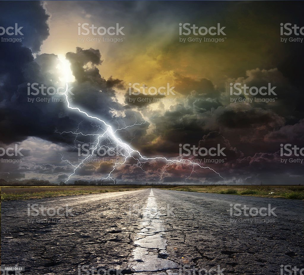 country road with lightning stock photo
