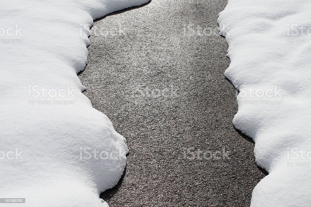 Country road with melting snow stock photo