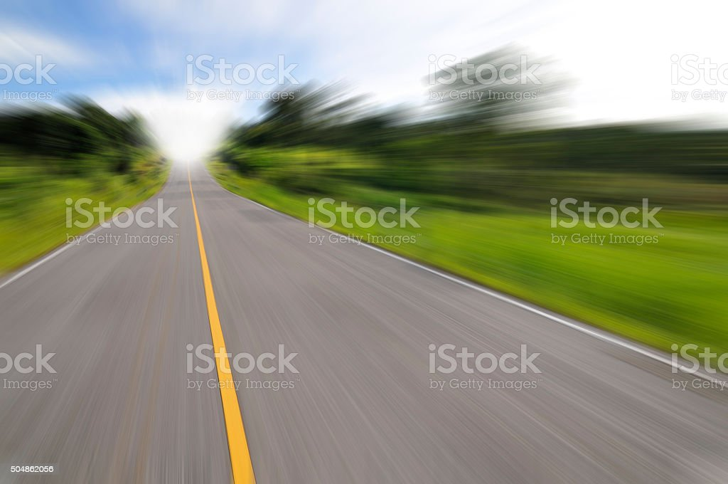 Country road with motion blur under blue sky stock photo