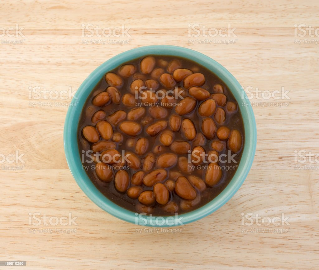 Country style baked beans in a bowl on table stock photo