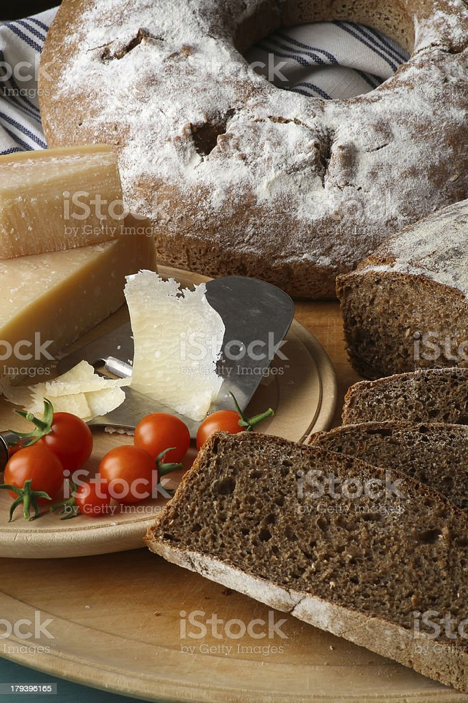 Country Style Rye Bread, Parmesan Cheese And Cherry Tomatoes royalty-free stock photo