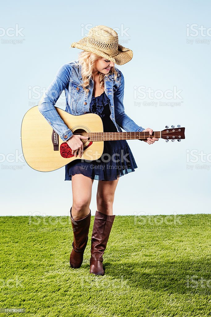 Country Western Girl Playing Accoustic Guitar royalty-free stock photo