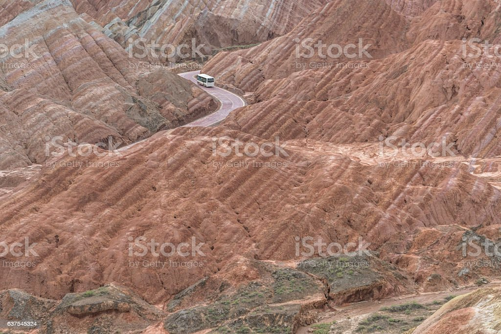 country winding road travel through Danxia landform stock photo
