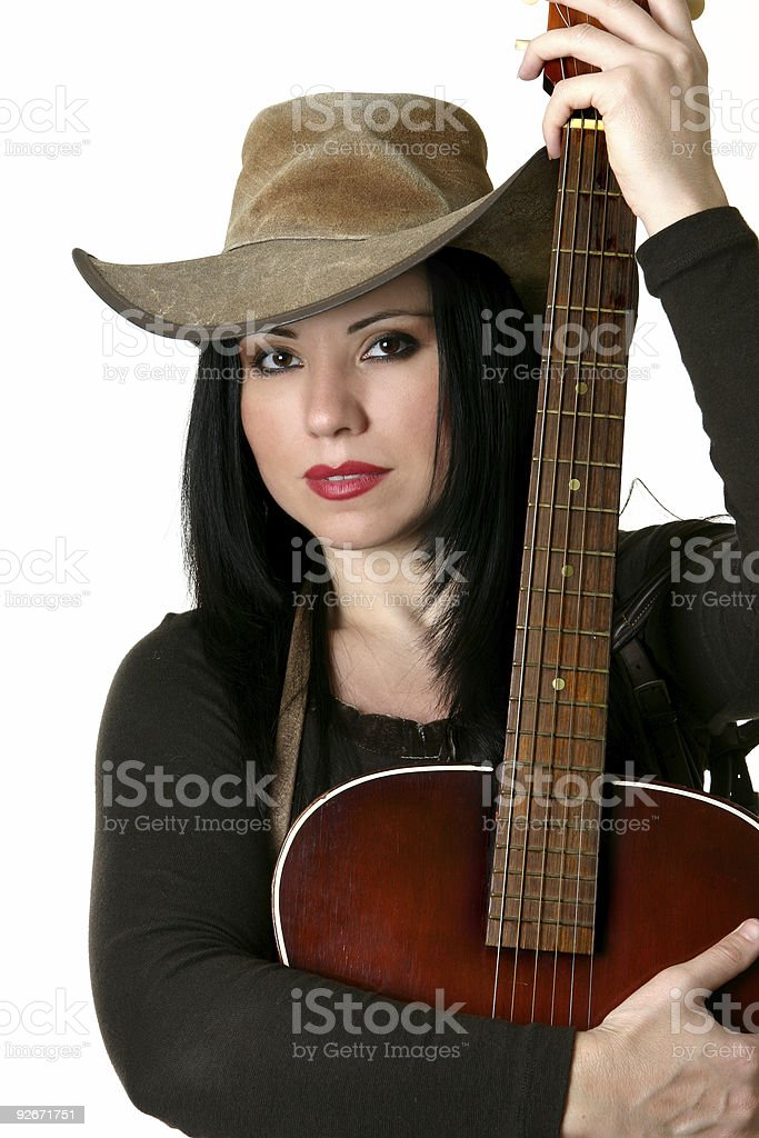 Country woman with acoustic guitar stock photo