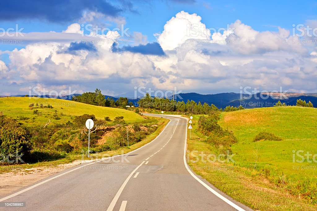 Countryroad with beautiful cloudshape stock photo