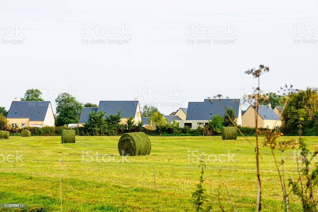 Countryside and haystacks in Normandy stock photo