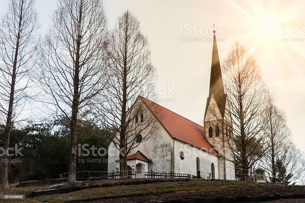 Countryside church in forest. stock photo