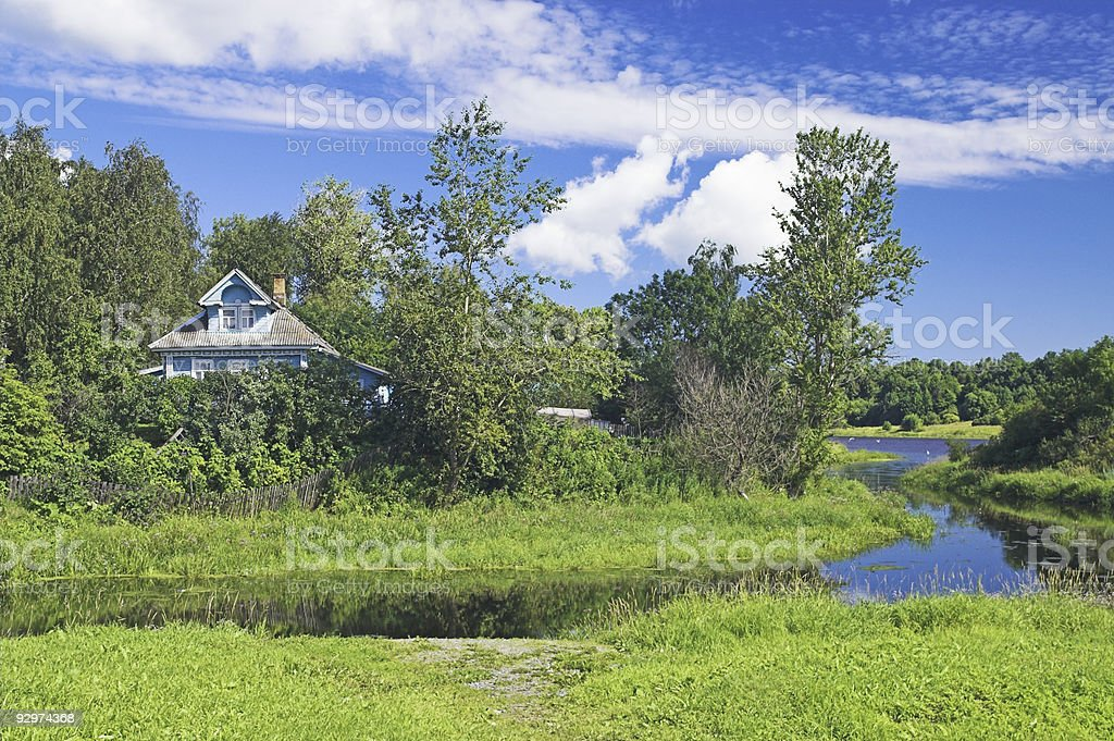 Countryside Cottage beside river bank stock photo