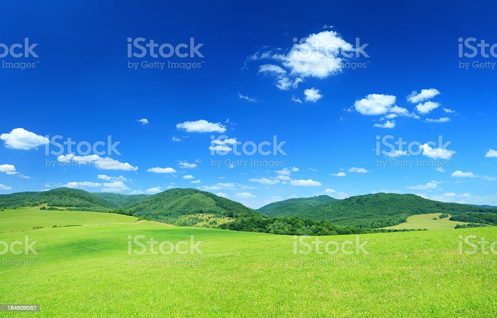 Countryside Landscape - Green Meadows Between the Hills royalty-free stock photo