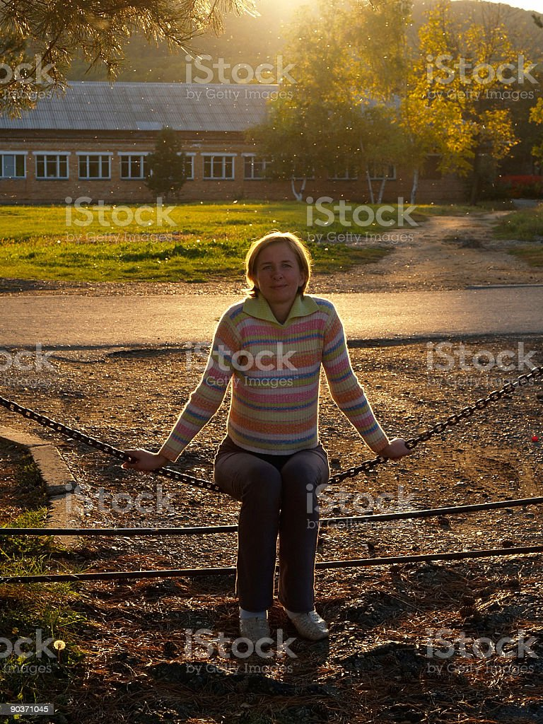 countryside portrait of happy girl against sunset stock photo