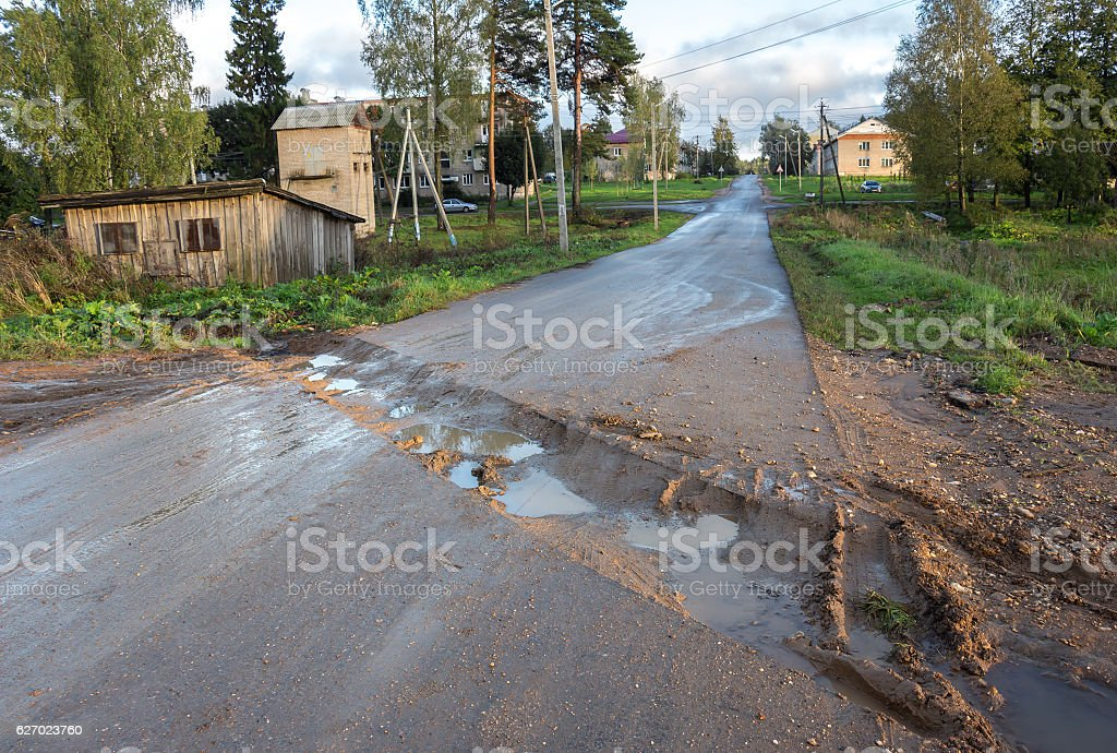 Countryside road. Rut with puddles stock photo