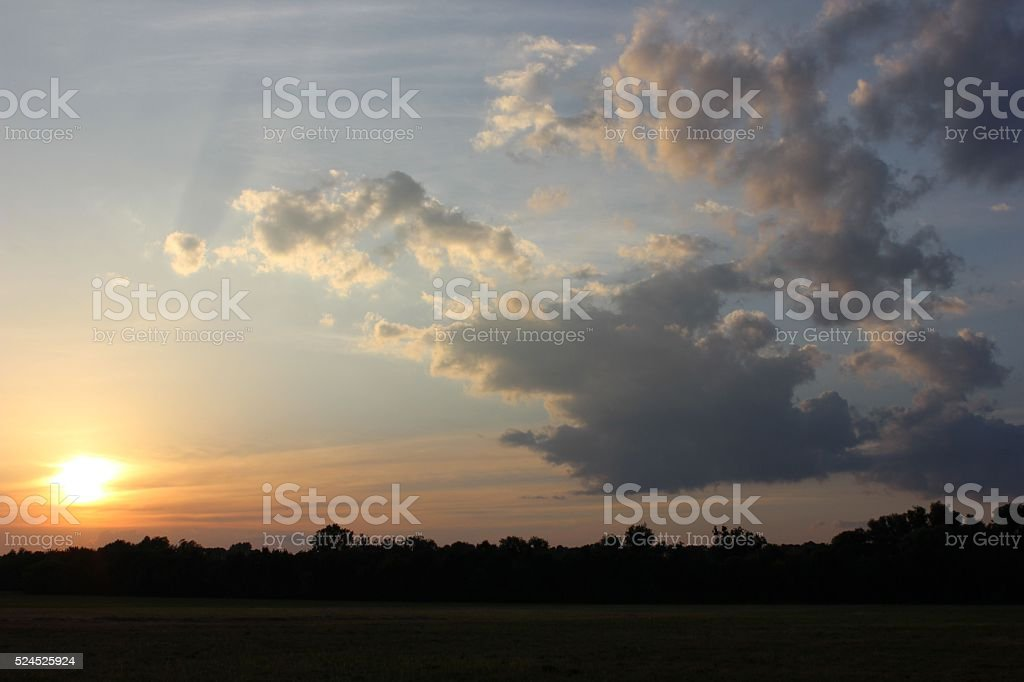 Countryside sunset sky with the clouds stock photo
