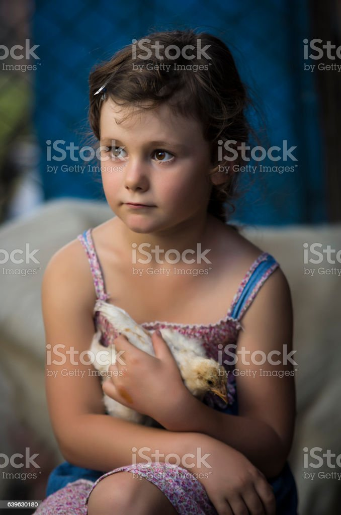 countryside young girl holding chick stock photo