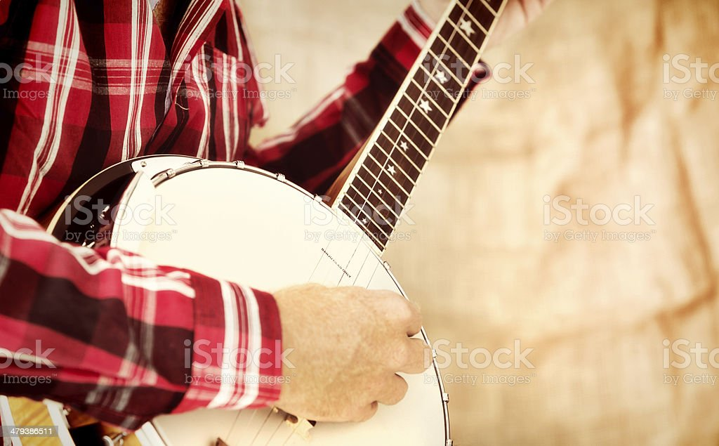 Country-style music being played on banjo royalty-free stock photo