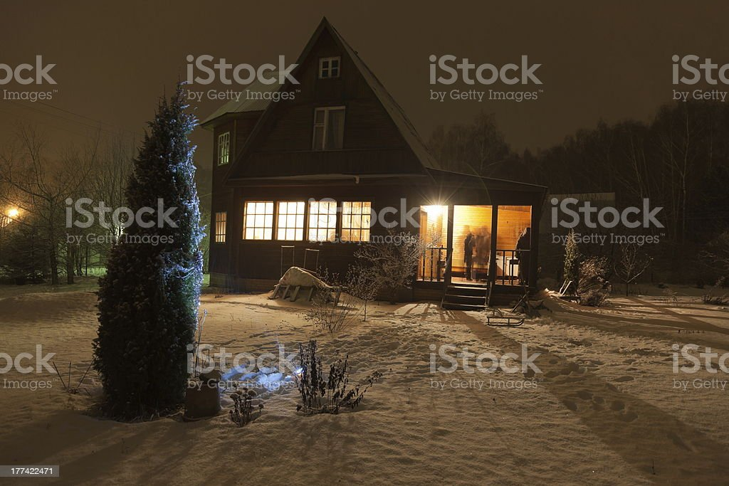 County house (dacha) and decorated Christmas tree. Moscow region. Russia. stock photo